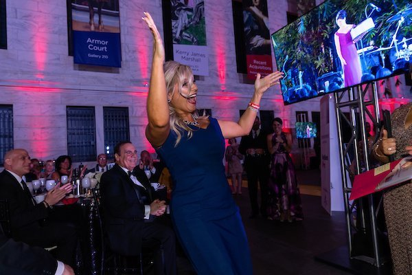fundraising event at the cleveland museum of art | excited woman in front of crowd at the 2018 cleveland heart and stroke ball