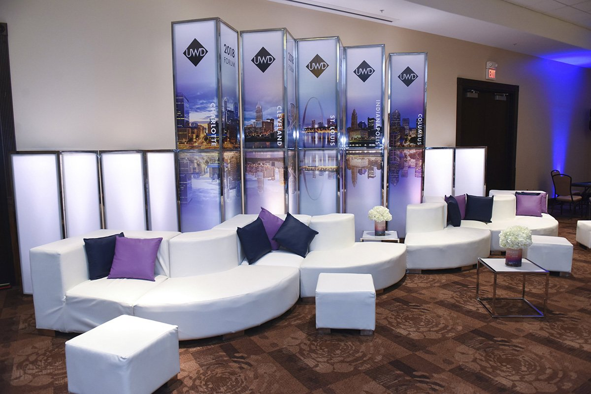 corporate event planners cleveland ohio | couches and ottomans on an event floor