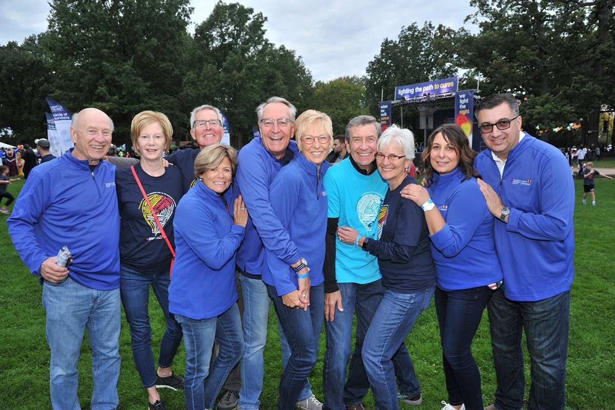 professional event planners near me | group of people dressed in blue at the 2018 LLS light the night