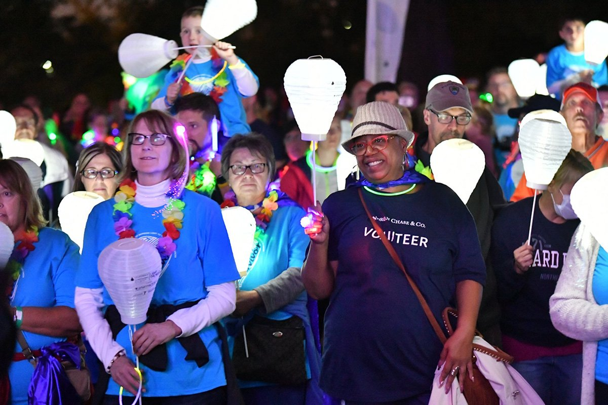 event planners cleveland | marchers with white lanterns light the night 2018