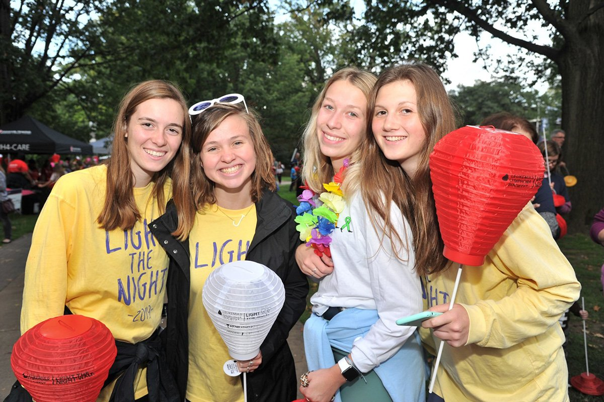professional event planners | LLS Light the Night 2018 volunteers in yellow shirts posing for the camera