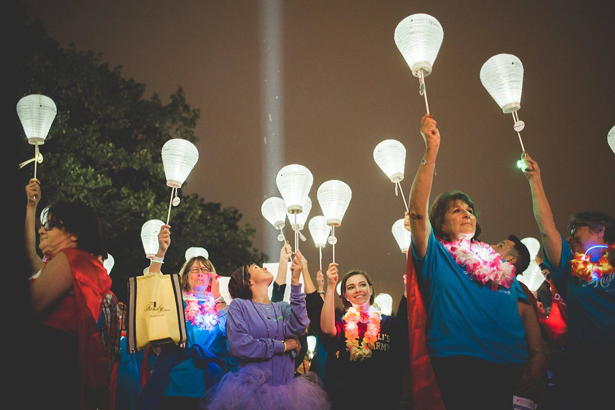 professional event planners | people marching with lanterns at night