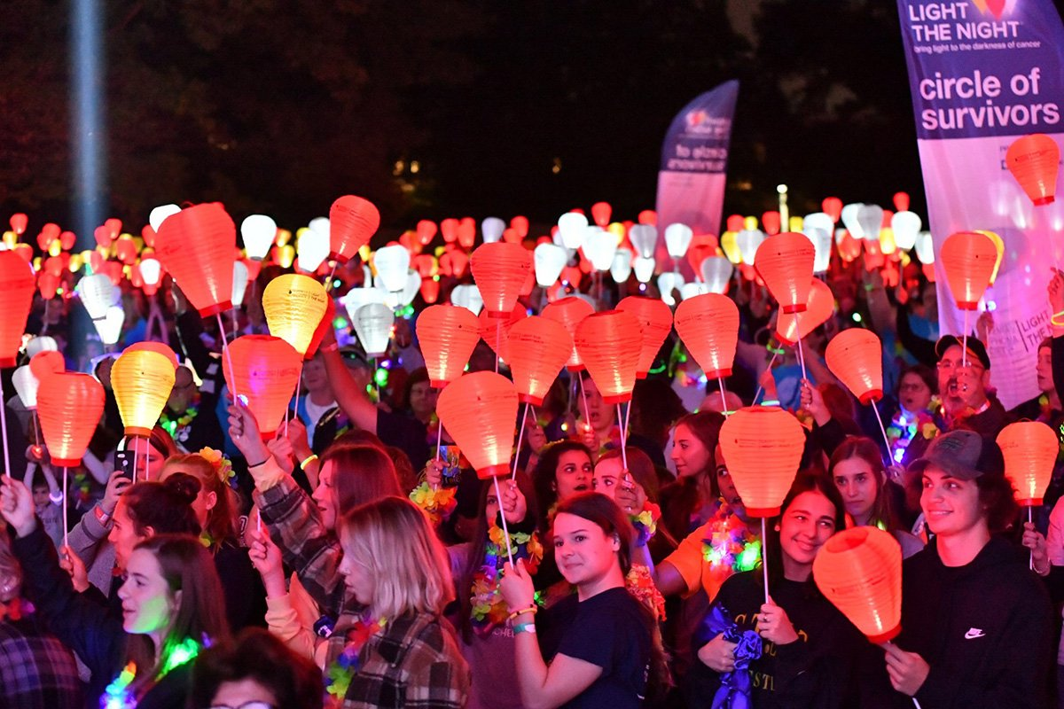 professional event planners cleveland ohio | crowd of people holding red lit lanterns
