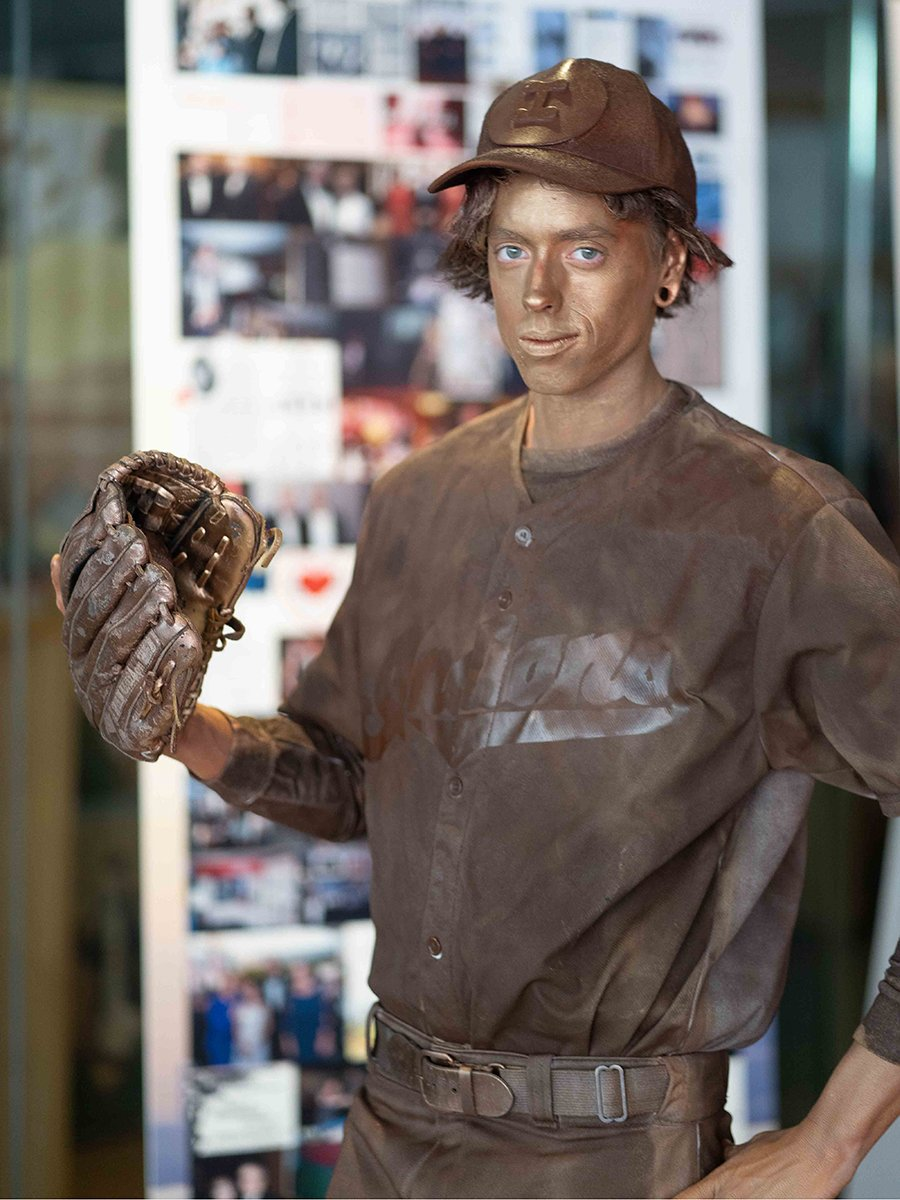 fundraising events | man dressed as a baseball player statue posing