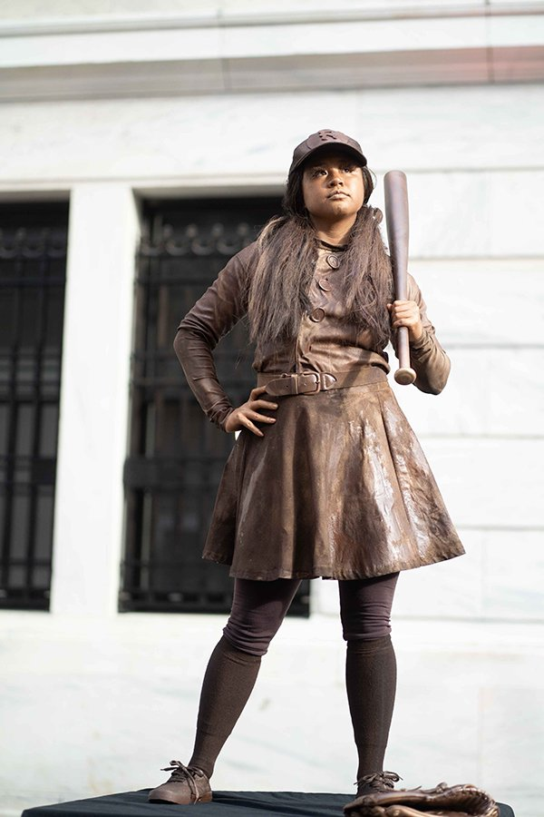 sports theme fundraising events | woman dressed as a baseball player statue