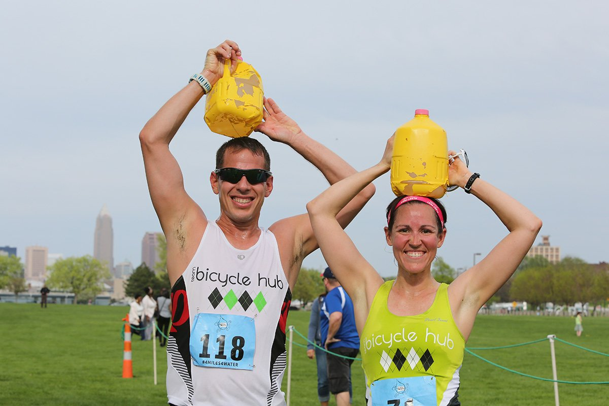 strategic event planning | two people with jugs of water over their heads