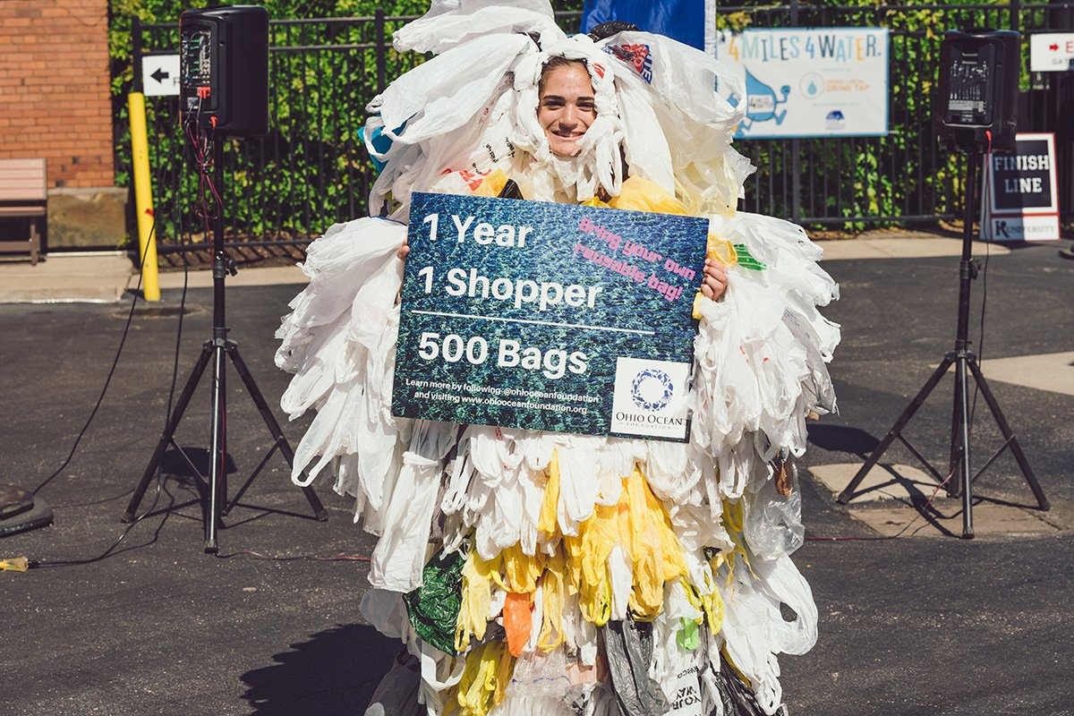 nonprofit event planning | person covered in shopping bags