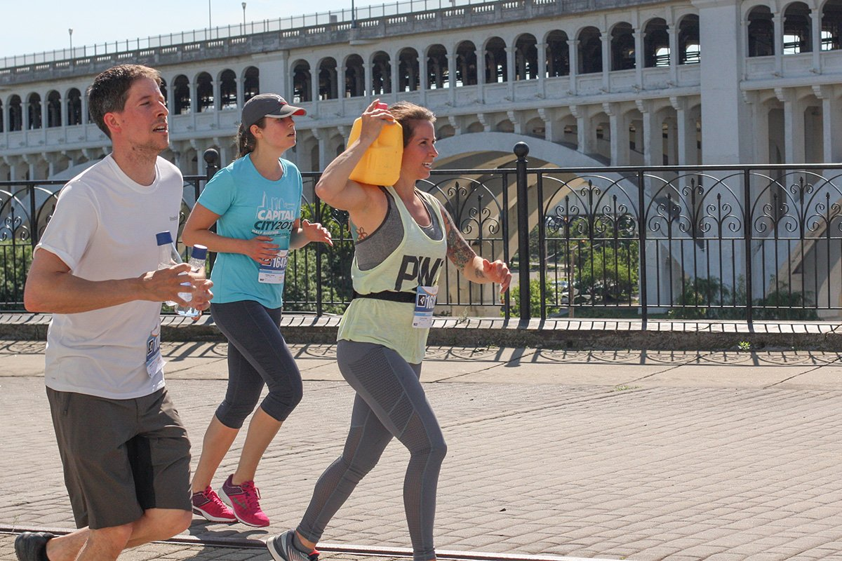 long-term nonprofit growth | people running with water in a 4K event