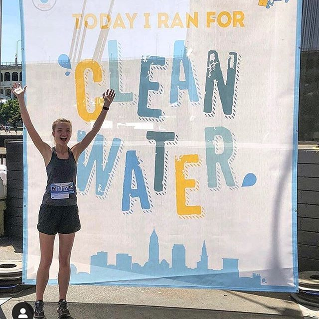 long-term nonprofit growth | cheering girl in front of clean water banner