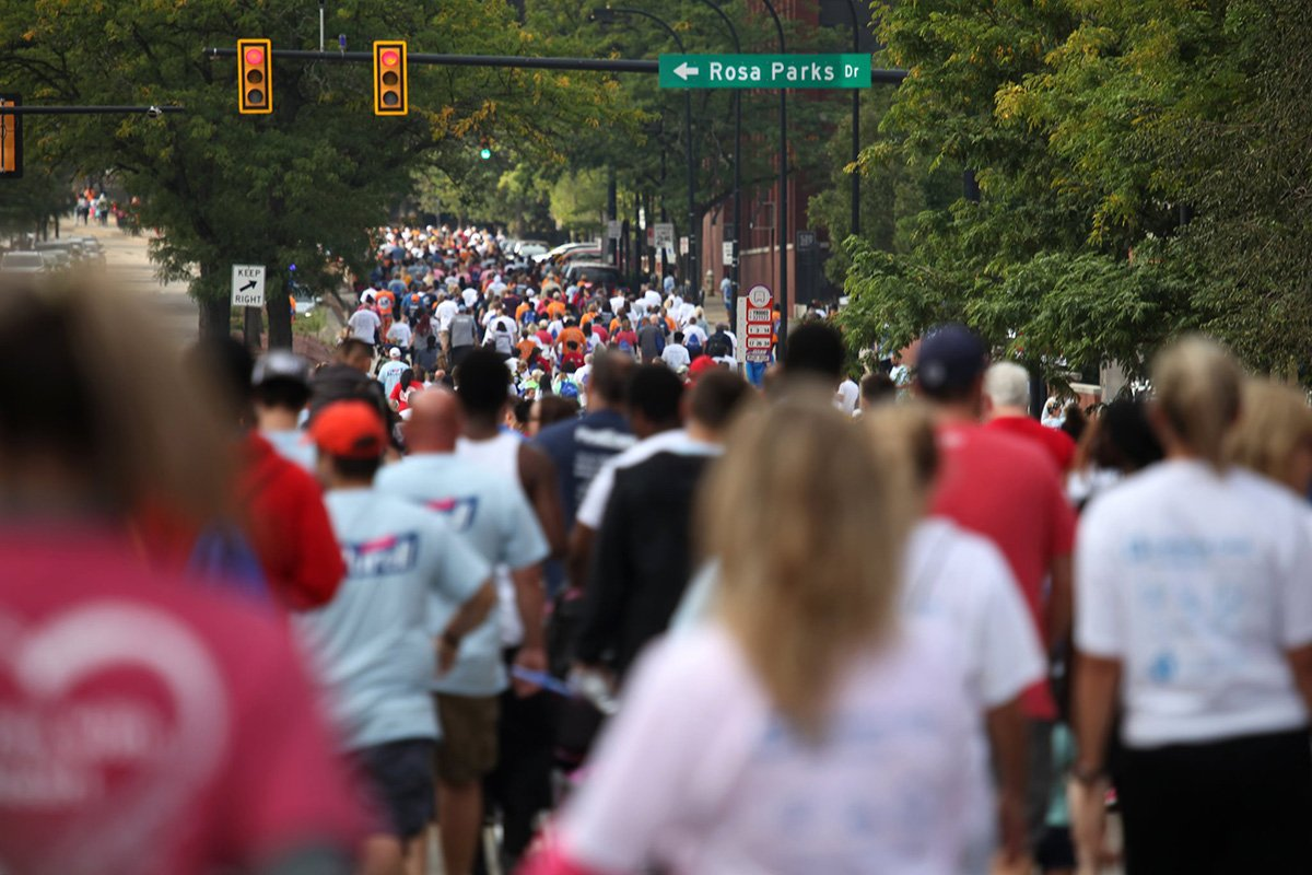 run-walk fundraisers | long line of people walking down the street at the akron heart walk 2019