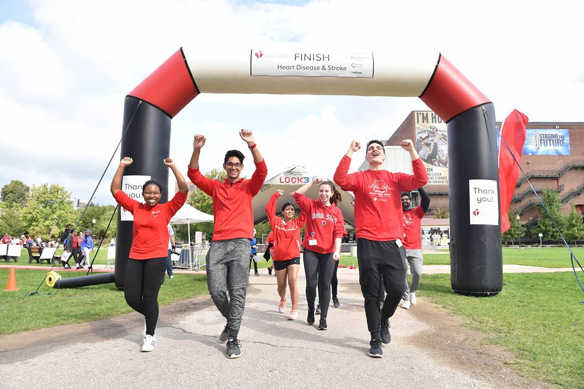 run-walk fundraisers | people crossing the finish line at the 2019 akron heart walk