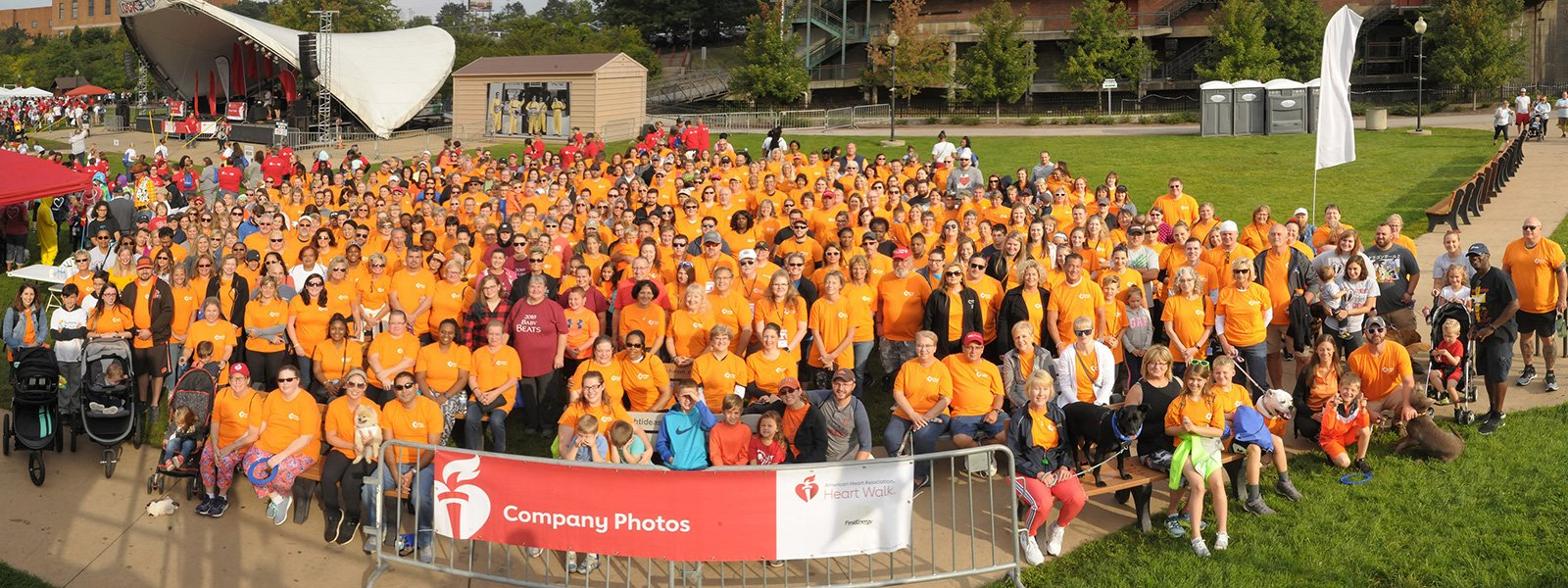 run-walk events akron cleveland | crowd of people posing in front of the american heart association banner