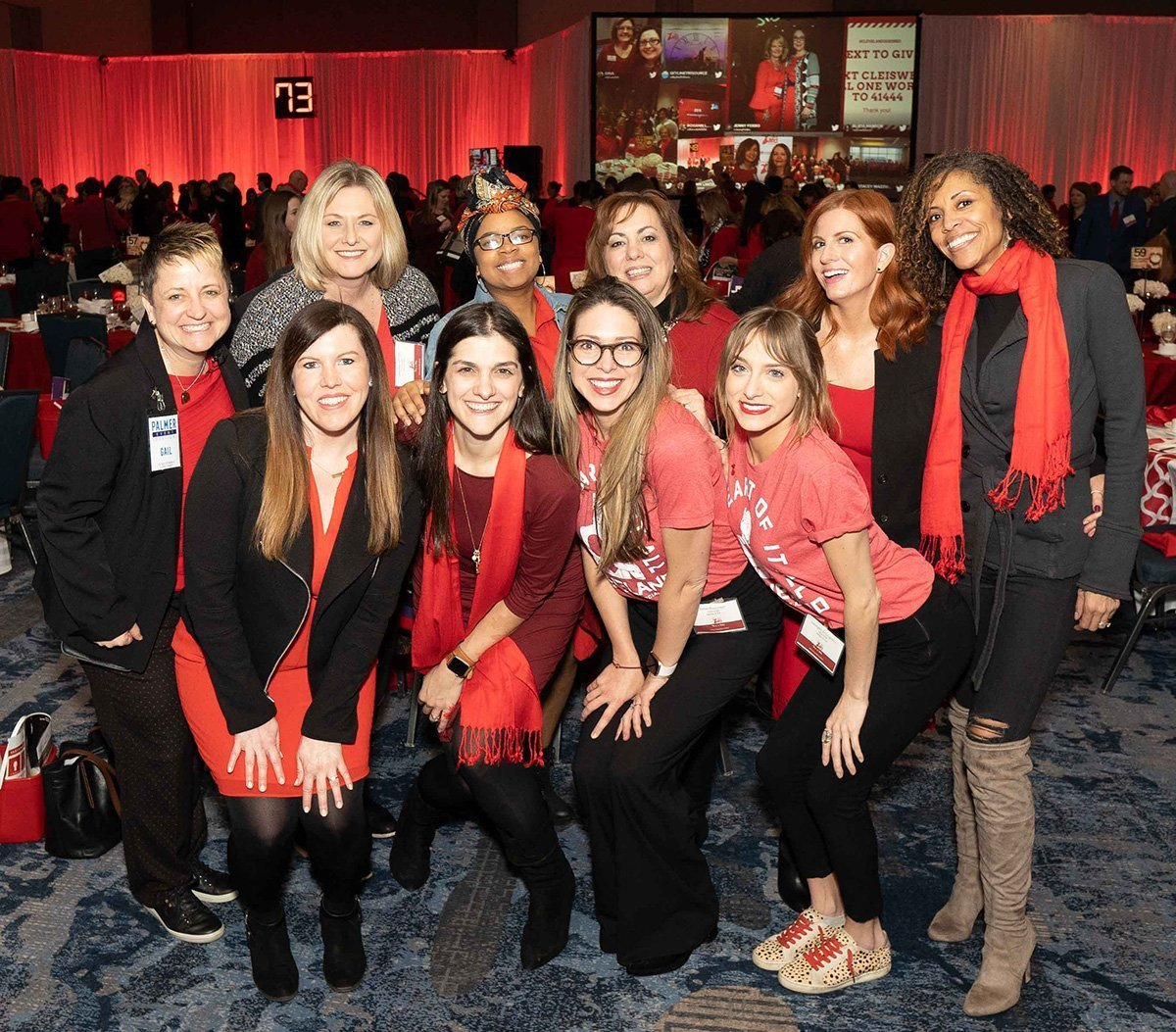 common event planning challenges | go red for women luncheon group photo