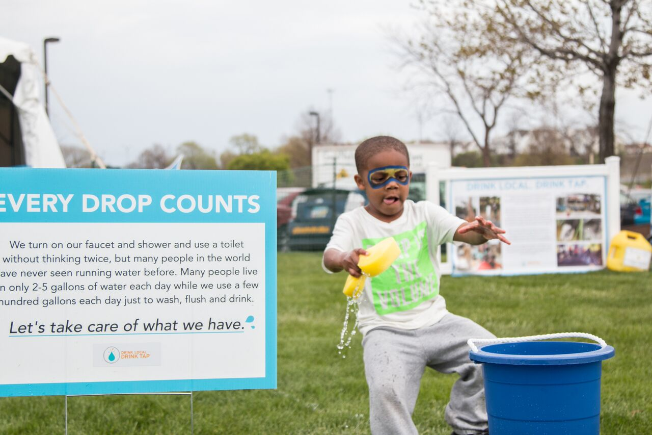 long-term nonprofit growth | child pouring out water on the ground