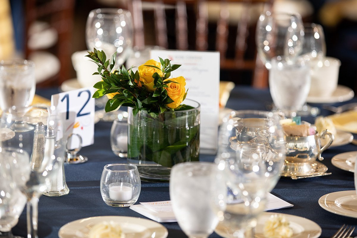 improve an annual fundraising event by simplifying | fundraiser formal table setting