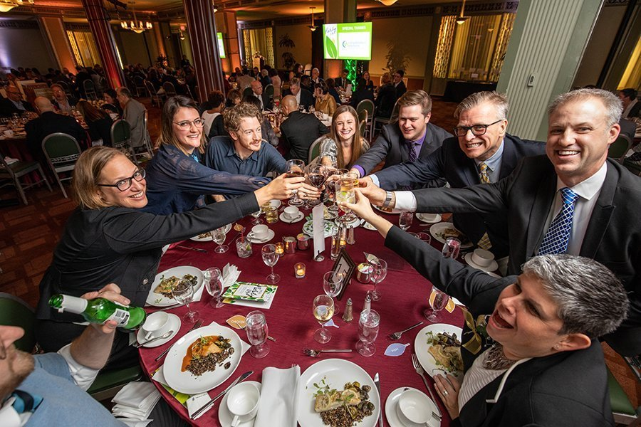 fundraising events cleveland ohio | people toasting wine glasses at the HFLA dinner