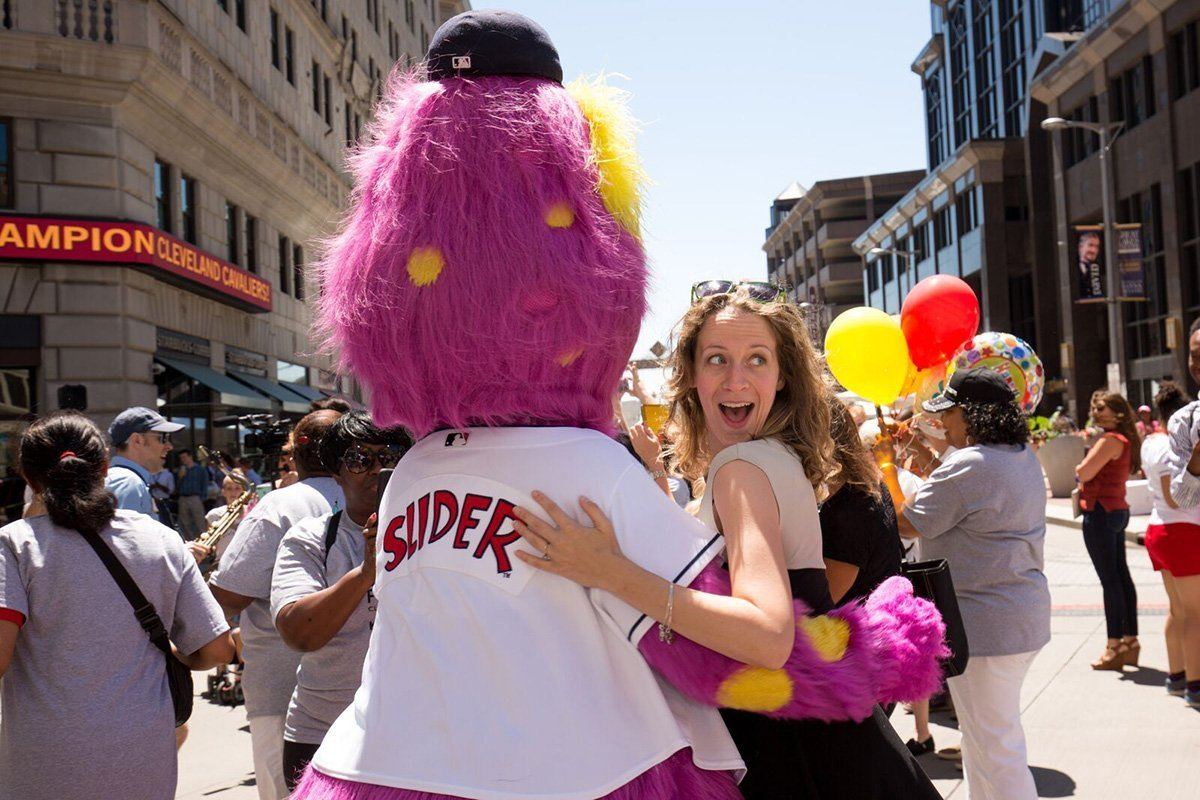 event planning cleveland ohio | woman hugging slider at the tri-c jazzfest