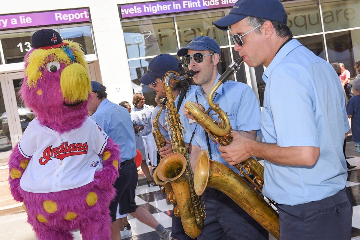 music festival planning | saxophonists and mascot at the tri-c jazzfest