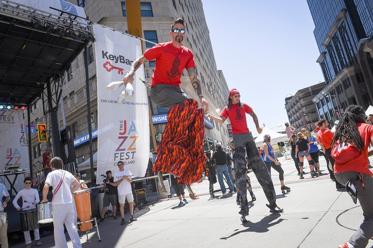 event logistics cleveland | two dancers on stilts with one jumping in the air