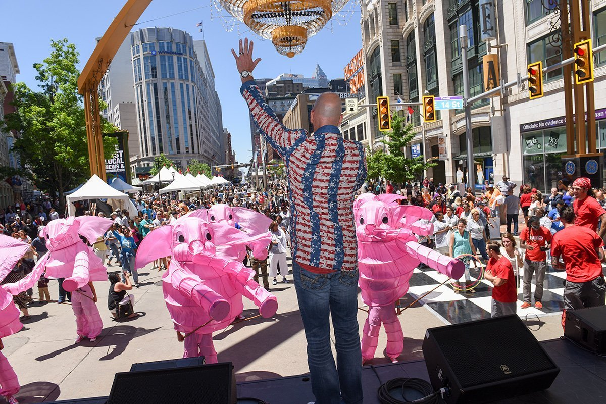 event planning cleveland ohio | announcer on stage at the tri-c jazzfest