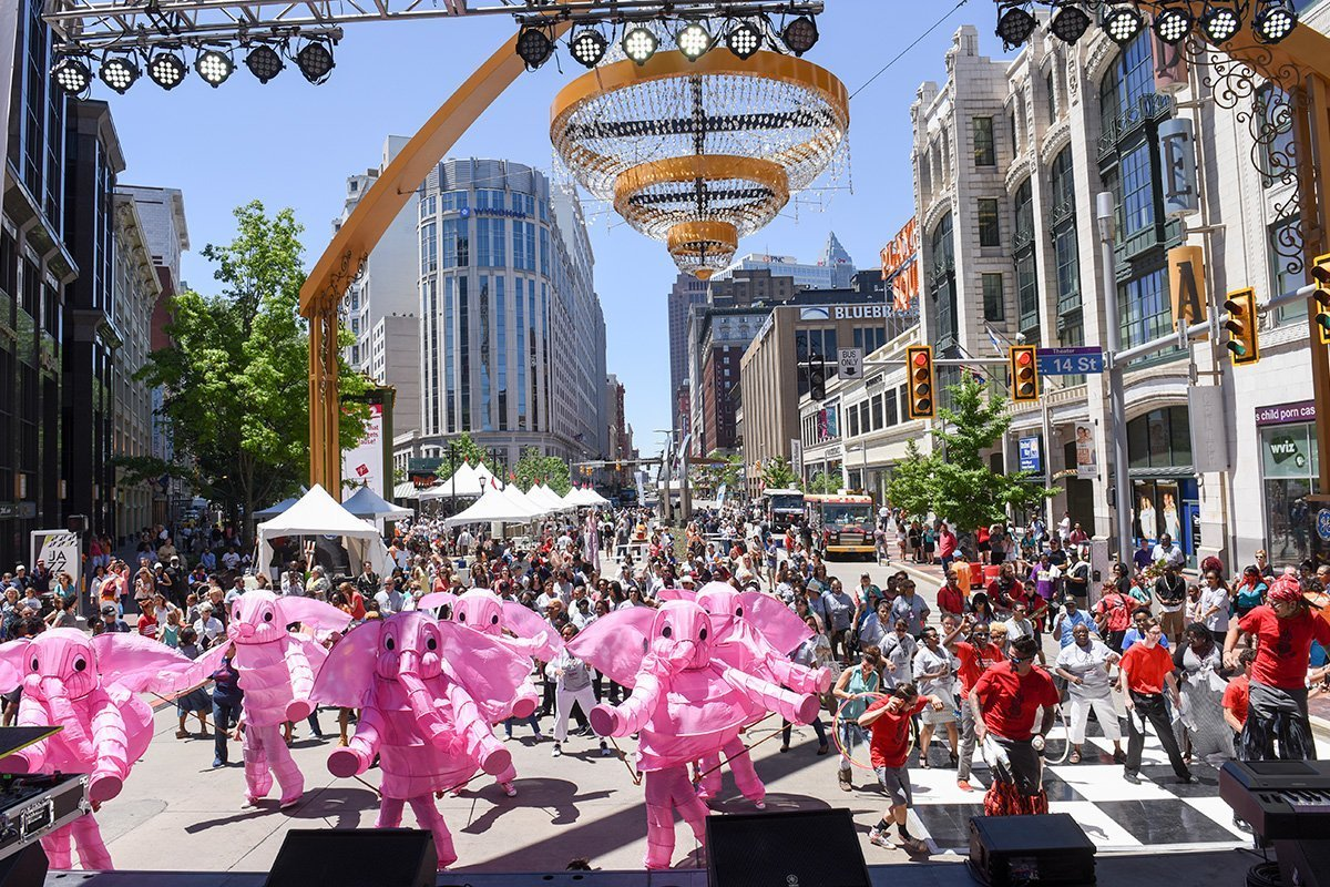 music festival planning | elephant mascots and jazz musicians playing in front of the stage